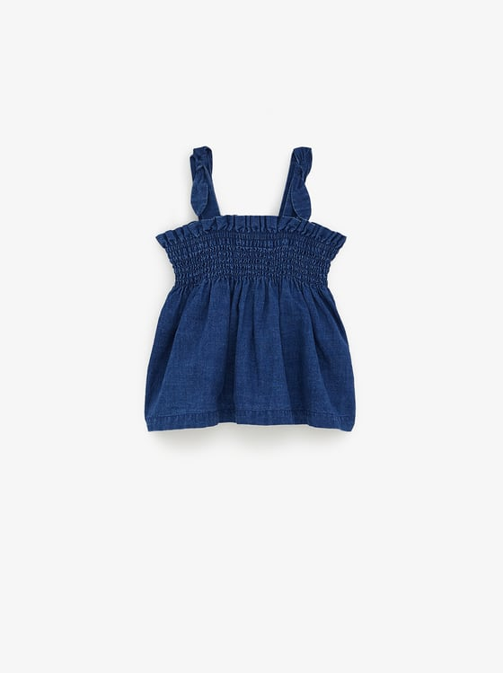 top en jean indigo a elastique de Zara sur SCANDALOOK