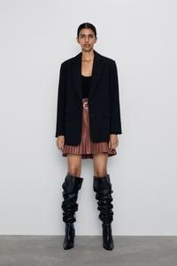 mini-jupe en cuir synthetique plissee de zara